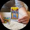 Hands holding Tarot cards